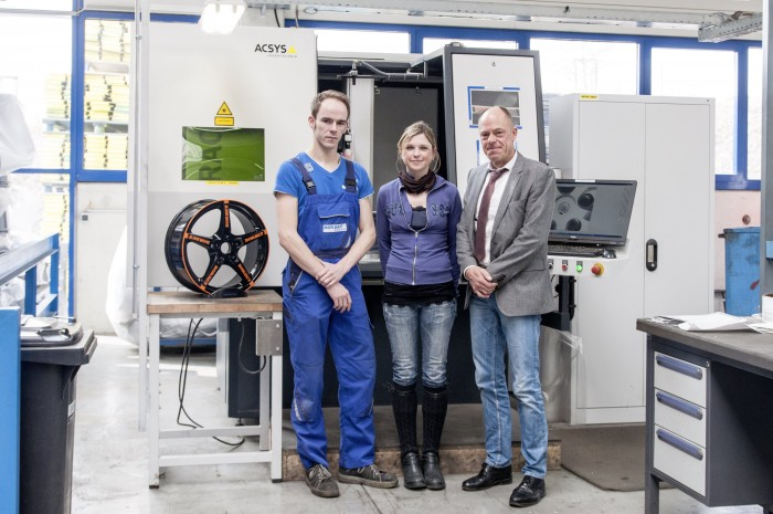 (from right to left) Peter W. BORBET jun., Marketing Manager Alexandra Marowsky and CNC specialist Sven Karpf standing in front of the BARRACUDA Multi BORBET laser processing system.